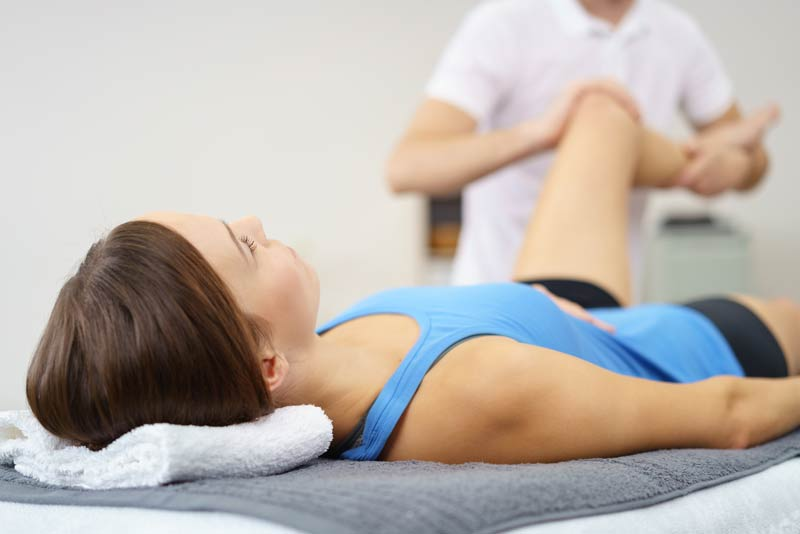 woman-being-treated-by-physiotherapist