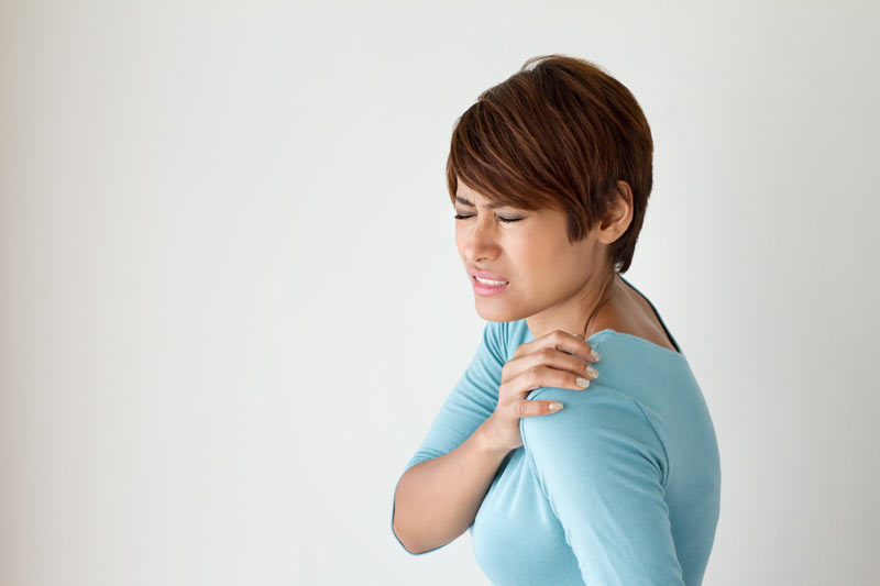 Physiotherapy patient - woman with painful shoulder